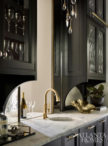 In the butler's pantry, the bespoke hardware is by Matthew Quinn Collection and the vintage goldleaf bowl is from Jim Thompson Atlanta.