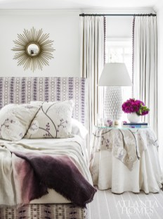 Layers of soft, tactile textures in the guest bedroom impart a peaceful ambiance. The custom headboard features Scalamandré's Nebula fabric.