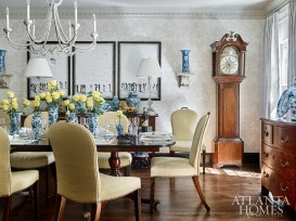 Murphy clad the dining room walls with Cole & Son's monochromatic Chippendale China wallpaper. The dining room chairs, purchased at Travis & Company, were also used in the clients' previous home.