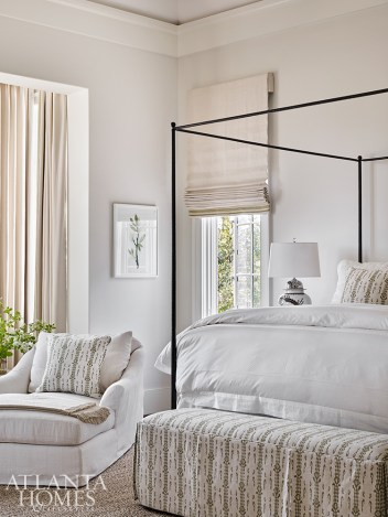 """For the master bedroom, """"the homeowners wanted it zen and very quiet,"""" says Webb. Tranquil fabrics, such as an Arabel linen, was used for draperies, and a softly patterned C&C Milano fabric appears on a bench and pillow."""