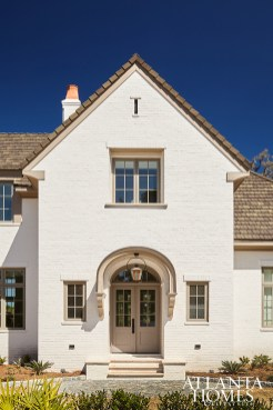 The painted-brick exterior lightens up the residence's footprint; the builder is Macallan Custom Homes and Renovations.