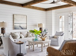 A fine art photograph from Stanton Home Furnishings brings the outside into the first-floor family room, a neutral milieu accented with colorful pillows covered in fabric by Jim Thompson.