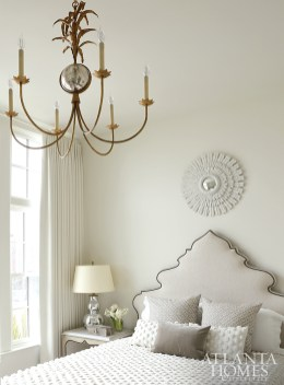An eye-catching headboard is the focal point of the Moroccan-inspired bedroom.