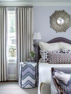 """The whole-house color palette takes a pause in the guest bedroom where soft shades of lavender were put front and center instead. """"The Newtons' daughter lives in Atlanta, but they wanted her to feel like she had a place at the new house,"""" says Mathison Glenn, who worked with her to cultivate the space."""