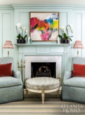 A technicolored abstract painting by Macon, Georgia artist Joe Adams provides an artful foil to the living room's many traditional elements.