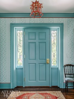 """""""It's so you!"""" That's the resounding sentiment when guests walk in Harriet's vivacious entryway. Mathison Glenn closely studied her existing pieces to create the coral-aqua scheme, which repeats throughout the house."""