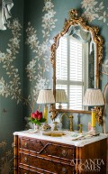 A powder room by Mallory Mathison Glenn features native Georgia flowers on a custom Gracie wallcovering. Photo by Jeff Herr.