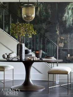 A 14-by-16-foot mural enlivens designer Kelly Anthony's foyer.