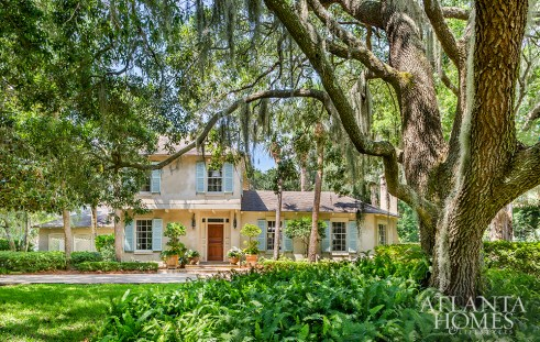 Framed by River Oaks swathed in Spanish moss, the Provincial blue shutters are an indication of the artful interiors within.