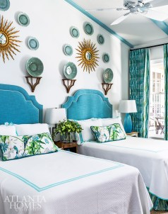 Coastal colors abound in the guest bedroom where an array of kelp-green plates floats above custom turquoise headboards.