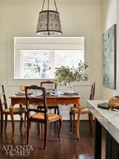One of the few patterns in the house, the custom light fixture over the breakfast table features a custom shade made from fabric by Morris & Co. through Jerry Pair.