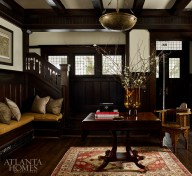 An antique Moroccan chandelier and an inlaid side chair, both from Foxglove Antiques & Galleries, play off of the original woodwork in the foyer.