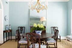 The dining room walls and ethereal painting create a calm setting for the owners' antique table and mahogany Chippendale chairs. A Circa Lighting chandelier adds sparkle.