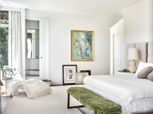"""A splash of green velvet brings a touch of the lush exterior into the zen-like master bedroom. """"Ginair wanted a zen room where she could escape to and unwind from the day,"""" says Millner. """"A cocoon to retreat to."""""""