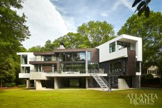 Designed by Jordan Williams of Plexus R+D and built by Michael McLaughlin of Craft, the home's boomerang-like shape affords water views from every room. The entire home, including the swimming pool, is elevated on concrete piers inspired by the ones supporting the bridge at West Paces Ferry.