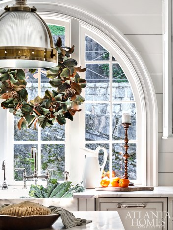 "To create a festive feel, Kirkland used magnolia wreaths from Lucy's Market throughout the home. ""Magnolia tends to last longer than evergreen garland and wreaths,"" she says."