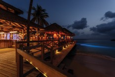The site of the Mustique Blues Festival and social center of the island, Basil's Bar shines by night.