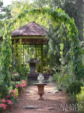 "Keith Robinson's eight-sided garden folly was inspired by a visit to English country gardens. He chose the acid green color to be a foil for the garden's ""hot"" orange, yellow and red blooms."