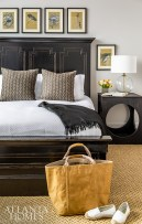 Dressed in bedding from Peacock Alley, a rustic bed fosters an informal, cozy milieu in a guest suite. The lamp is from Townhouse by Robert Brown.