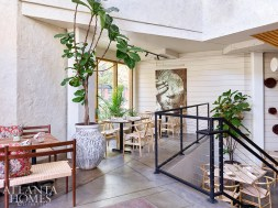 Delbar owner Fares Kargar infused interiors with design elements inspired by his grandmother's village in Iran, including plaster walls and Iranian art.