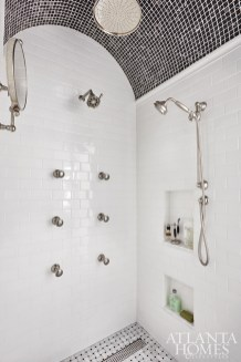 "A double-entry shower with a mosaic-tiled barrel ceiling joins the his-hers sections of the master bath. ""The client himself came up with the ideas about the ceiling,"" says Neely."