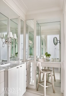 Mirrors were integral for bringing light into the windowless bathroom, and are featured on all of the walls in the space. The faucet and lighting is Waterworks.