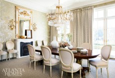 A hand-painted wallcovering by de Gournay through Ainsworth-Noah creates a stunning backdrop. The chandelier is Paul Ferrante and the artwork on the mantel is by Hunt Slonem.