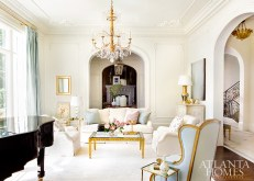 A chandelier in 22-karat gold from Paul Ferrante plays off of the similar tones throughout the music room.