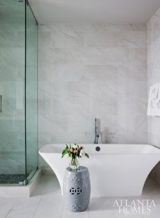 A modern soaker tub by Victoria + Albert and a stand-alone shower foster a spa-like feeling in the master bathroom.