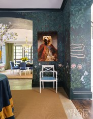 Through lush foliage and meaningful quotes, the hand-painted wallcovering by Bethany Travis echoes the sense of whimsy that designer Melanie Turner infused into the interiors. The bear painting is from Art Addiction.