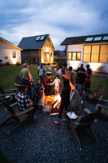 Residents enjoy amenities such as the Micro Village's community fire pit.