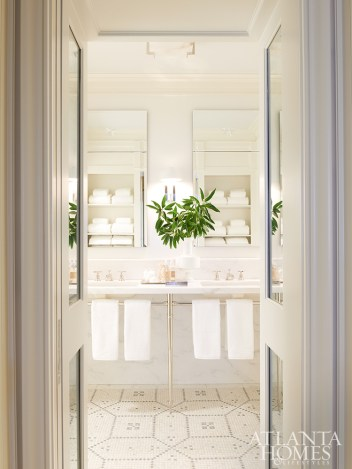 To offer the illusion of more space in the windowless master bath, storage is located on the back wall.