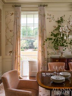 A hand-painted chinoiserie wallcovering by de Gournay provides an anchor of elegance in the dining room.