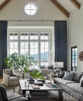 Thanks to the 16-foot window, designers Melanie Millner and Katie Moorhouse took advantage of nature's palette by infusing an array of blues, creams, taupes and grays into the living room. The coffee table is a custom piece made by Kevin Scanlon.