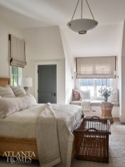 It was all about texture in the daughter's room; she requested a neutral palette with subtle pops of color. The designers used a nubby wool area rug and infused burnt orange hues in the window seat, pillows and bedding.
