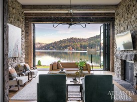 Luxe furnishings, such as a channel- tufted leather sofa from Bungalow Classic and chaise lounges covered in mohair from Pindler, juxtapose the Tennessee fieldstone walls and rough-hewn reclaimed wood beams in the living room.