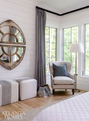 An antique mirror grounds the opposite end of the master bedroom.