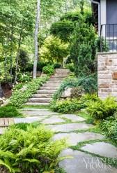 Boulder slab steps nestled into the landscape offer the home a sense of permanence.