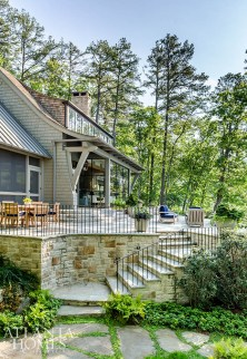 The oversize brackets and sweeping wall of wood shingles were created with function in mind; Duffey's design dictated steel-and-glass pocket doors between the kitchen and screened porch.