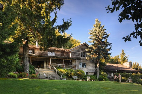 The Swag Main House and lodge, constructed from reassembled historic log buildings.