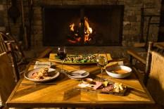 Cozy fireside dining.