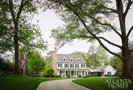 Designed by Atlanta architect Norman D. Askins and interior designer Susan Bozeman, this sprawling North Buckhead home exudes farmhouse charm. The landscape was designed to make the house feel as though it's been there for a long time, nestled into the land.