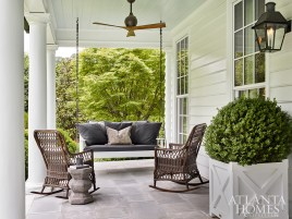 """""""There's nothing more welcoming in the world than a house with a porch out front,"""" says Askins, who purposefully sited this North Buckhead home low to the ground to create a tight relationship with the 3-acre landscaping."""