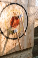 Axe throwing is a popular activity.
