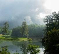 Early morning mist rises above the 35-acre Hampton Lake.