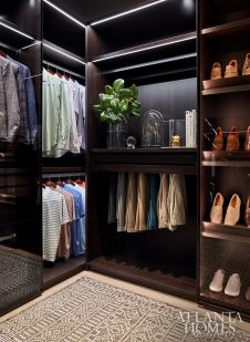 his closet with custom dark wood cabinets