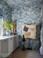 teal ceramic tile laundry room