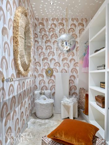 closet with a graphic Louee Vega wallpaper, ballerina bar and a disco ball