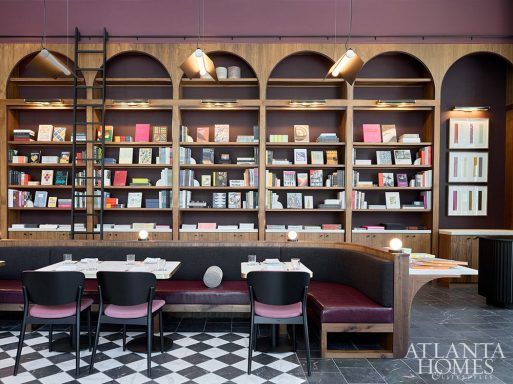 """A wall-to-wall bookshelf houses books curated by Katie Barringer. """"I was determined to display them in a way that they would not disappear or look like a decorative after-thought."""""""