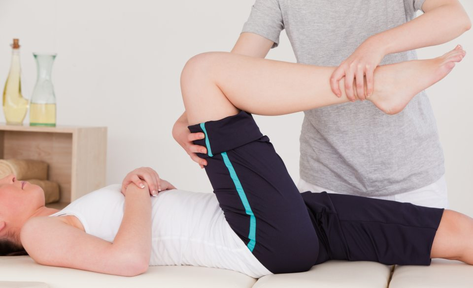PT assessing movement 1024x625 - How to Treat Tailbone Pain with Physical Therapy